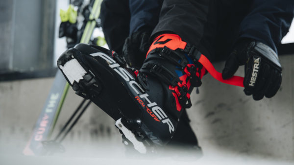 person putting on ski boot
