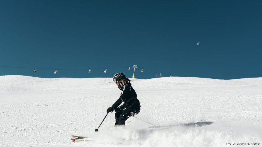 person skiing infront of blue sky