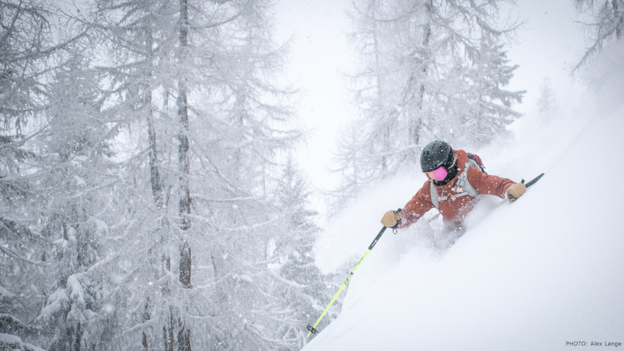 person skiing in deep powder snow