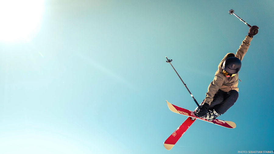 alpine skier jumping blue sky